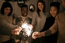 Friends With Sparklers On Party