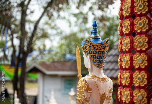 the idol statue colorful statue back view , hindu god idol at front