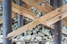 Worn Wooden Trusses And Stones Under Old Bridge On Cloudy Day 1