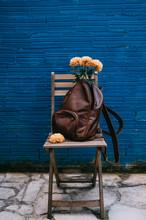 Flowers Inside A Leather Backp...