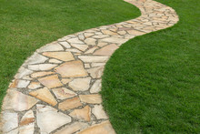 Stone Path On Green Grass In T...
