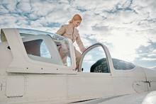 Female Pilot On Small Plane