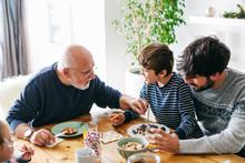Family Eating Breakfast On Christmas Morning.