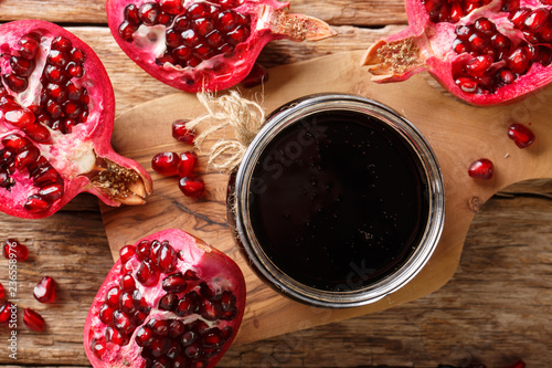 Azerbaijani narsharab seasoning obtained by thickening pomegranate juice close-up. horizontal top view