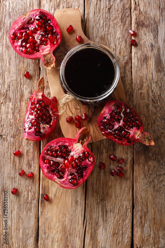 Fotobehang Aromatische Delicious spicy pomegranate sauce narsharab with spices for seasoning meat dishes close-up. Vertical top view