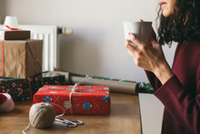 Woman Wrapping Christmas Presents Indoor