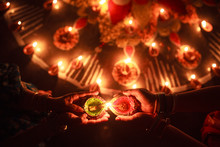 Woman Enlightening Diya In Ran...