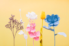 Variety Of Colorful Flowers On Yellow Background