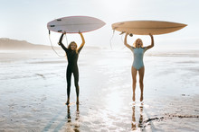 Young Girl With Her Surf Teacher