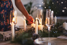 Lighting Candles For Christmas Table Setting