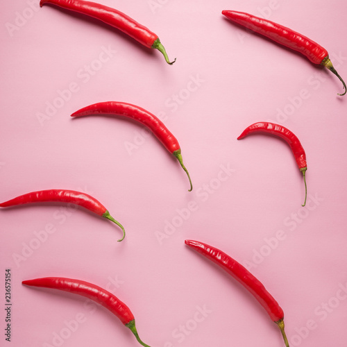 Creative layout of chili pepper on pink background. Minimal food concept.