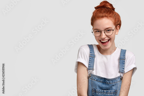 Fotografie, Obraz  Horizontal view of pleased freckled young girl with ginger hair, feels satisfied