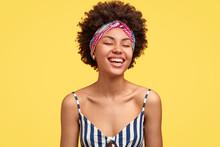 Joyful Dark Skinned Model Laug...