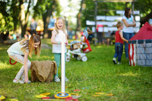 Children Playing Ring Toss Game During Annual Medieval Festival, Held In Trakai Peninsular Castle.