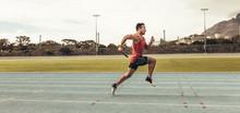 Sprinter Running On Track In A Stadium