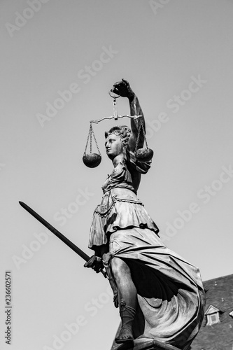 Fotobehang Art Studio Statue of Lady Justice in front of the Romer in Frankfurt - Germany