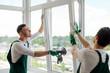 Leinwandbild Motiv Workers installing a window