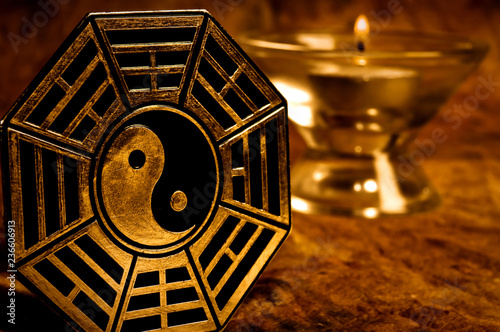 Fotografie, Obraz  yin yang with i-ching symbols with candle in background