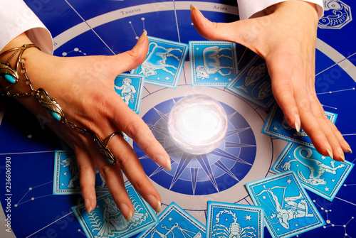 Photo Fortune teller astrologer with astrology esoteric tools
