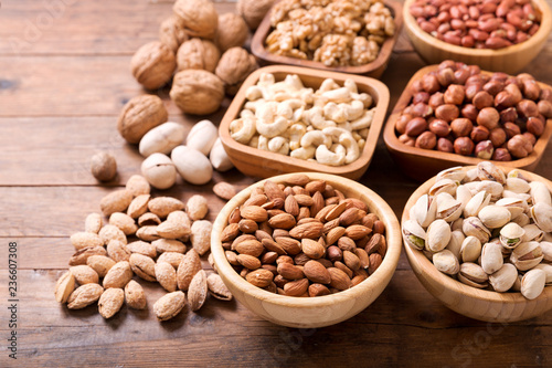 bowls of nuts on wooden table