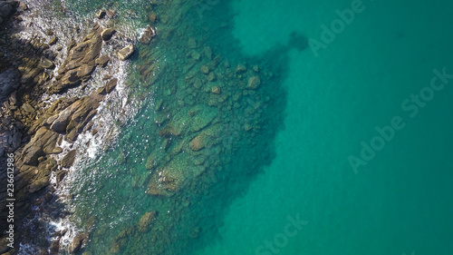 Aerial drone top view of transparent shallow water and sea ocean surface Wallpaper Mural