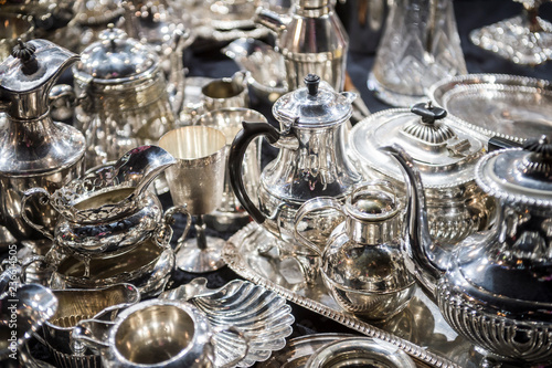 Shiny abstract background of antique silver tableware pieces in a full frame lux Wallpaper Mural