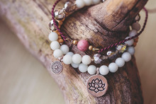 Three Natural Mineral Stone Beads Bracelet On Wooden Background