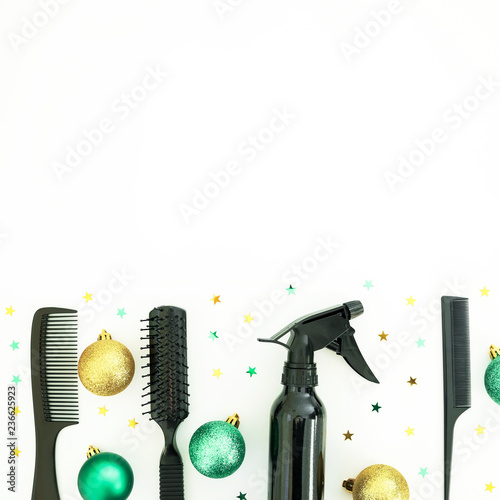 Fotografie, Obraz  Christmas hairdresser composition with spray, combs and decoration on white background