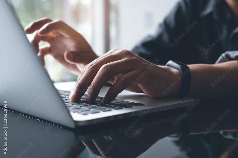 Fototapeta Working on laptop computer