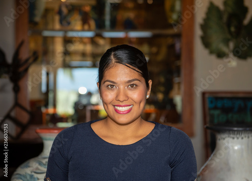 Happy, Smiling, Friendly & Beautiful Mexican Woman Working in a Resort Hotel in Wallpaper Mural
