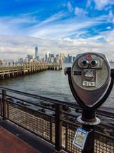 Binoculars On Bridge With View Of Manhattan