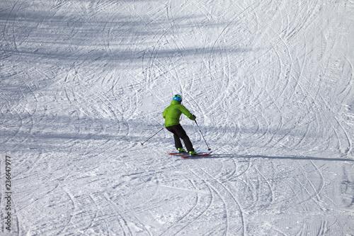 Skier descent on snowy ski slope
