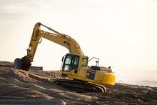 Excavator At The Beach