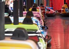 Bump Cars In Amusement Park