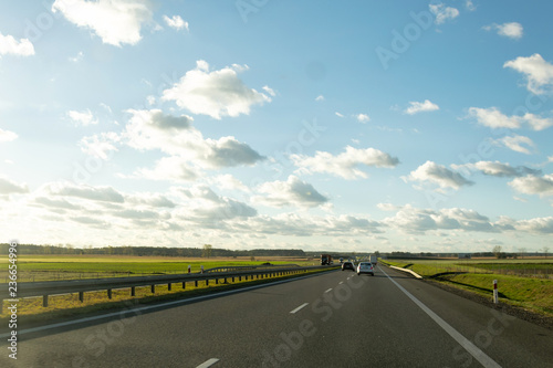 Fotografiet  road sun and sky