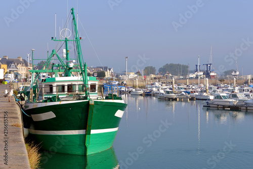 Keuken foto achterwand Poort Fishing boat in the port of Saint-Vaast-la-Hougue, a commune in the peninsula of Cotentin in the Manche department in Lower Normandy in north-western France