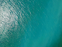 Sea From Above, Ocean  Water Surface Aerial View, Water Texture Background, Light Blue Green Reflection On Lake Wave Ripples Flat Surface.
