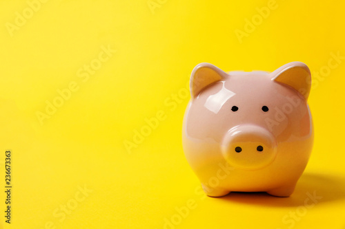 Fototapeta Pink piggy bank isolated on yellow colourful trendy modern fashion background. Saving investment budget wealth business retirement, financial, money, banking concept. Copy space obraz