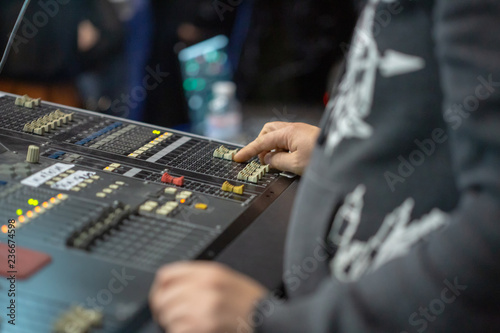 Soundman working on the mixing console. - 236674598