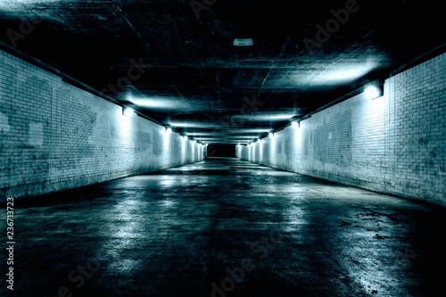 Empty underground tunnel at night