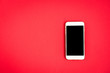 Leinwanddruck Bild - Mobile phone on red background