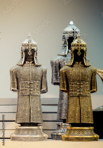 Photo  Medieval steel and gold colored armours on display