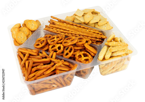 Keuken foto achterwand Buffet, Bar Pack of savoury pretzel and cracker snack mix isolated on a white background