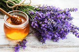 Fototapeta Lavender - Jar with honey and fresh lavender