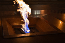 The Eternal Flame Burns At Night Near The Monument To Soviet Soldiers For Victory In World War II.