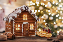 Gingerbread House On The Christmas Table With Copy Space