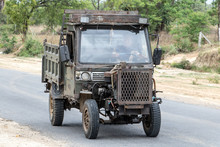 Chinese Manufactured Tractor Truck Ride On Road At Countryside Of Myanmar. Typical Open-fronted Battered Lorry Vehicle With Air-cooled Engine, Burma.