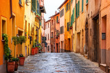 Fototapeta Uliczki - Beautiful alley in Tuscany, Old town Montepulciano, Italy