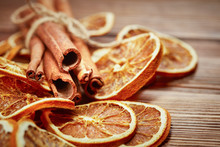 Dry Citrus Fruits, Cinnamon Sticks And Anise On Wooden Background