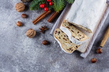 Traditional Christmas Festive Pastry Dessert With Festive Decoration. Christmas Stollen On Concrete Background. Top View, Copy Space